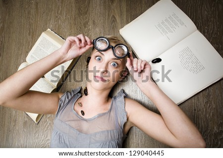 portrait of crazy student in glasses with books and cockroaches - stock photo