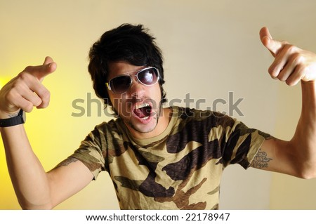 Portrait of crazy young man yelling and gesturing - stock photo