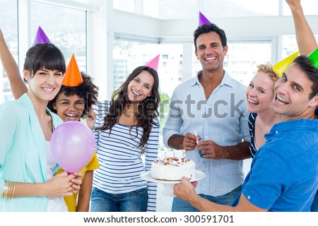 Portrait of creative business people celebrating a birthday - stock photo