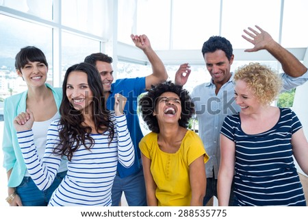 Portrait of creative business team having fun in the office - stock photo