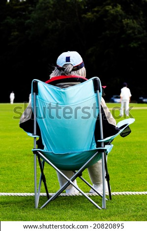 portrait of cricket spectator - stock photo