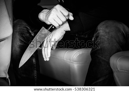 Portrait of criminal man hands holding knife,Crime concept