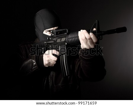 portrait of criminal with m4 rifle - stock photo