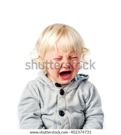 Portrait of crying and sreaming little boy isolated on white background