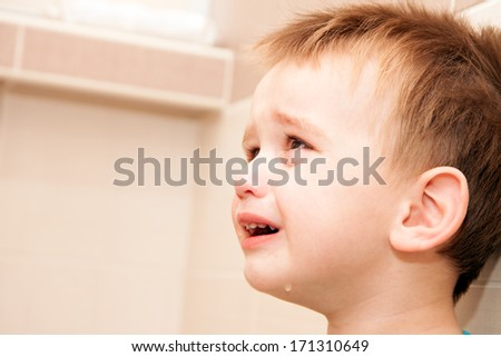 Portrait Of Crying Baby Boy In Home. - stock photo