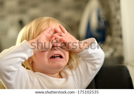 Portrait of crying baby girl.  - stock photo