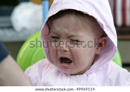 Portrait of crying baby girl - stock photo
