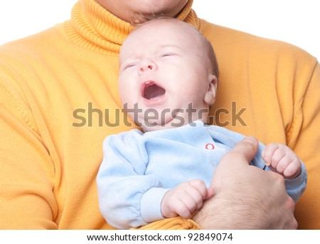 Portrait of crying baby on fathers hands - stock photo