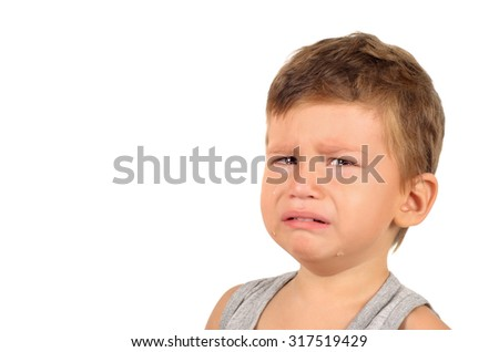 Portrait of crying little boy isolated on white background - stock photo