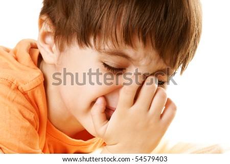 Portrait of crying little boy, isolated on white background - stock photo