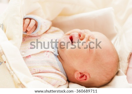 portrait of crying newborn baby girl