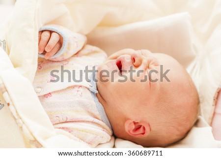 portrait of crying newborn baby girl - stock photo