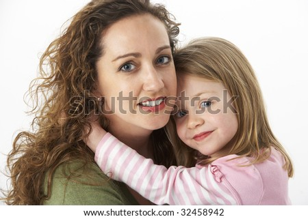 Portrait Of Cuddling Mother And Child