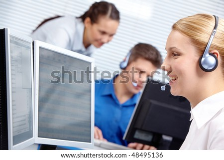 Portrait of customer representative working on the background of colleagues