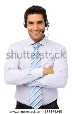 Portrait of customer service representative standing arms crossed over white background. Vertical shot. - stock photo