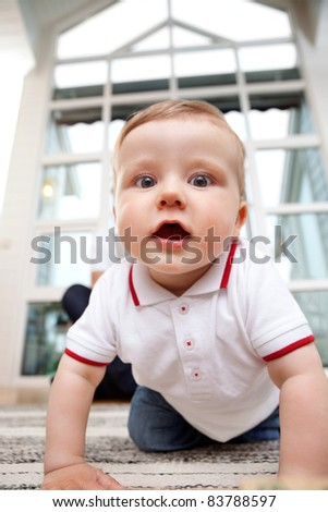 Portrait of cute adorable child at home - stock photo