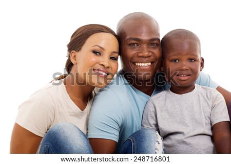 portrait of cute african family of three sitting on white background