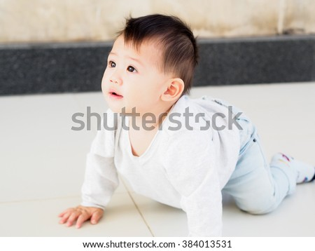 portrait of cute Asian baby with expression. - stock photo