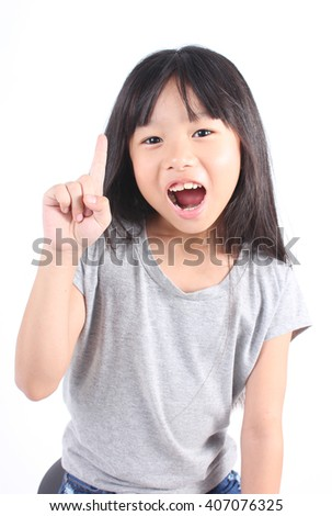 Portrait of cute asian girl point up on white background. - stock photo