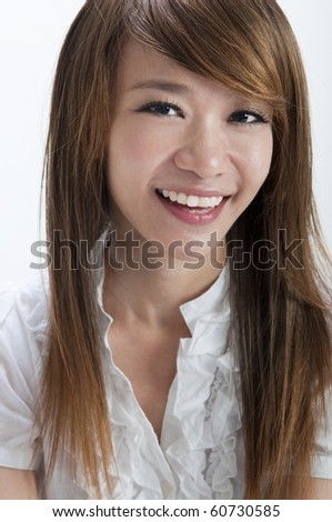 Portrait of cute Asian girl smiling on white background - stock photo