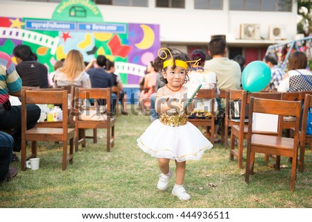 Portrait of cute asian girl with fancy costume at school event