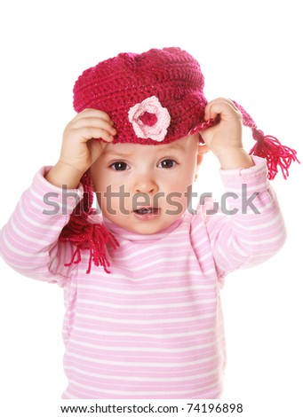 Portrait of cute baby girl in funny pink hat isolated on white background - stock photo