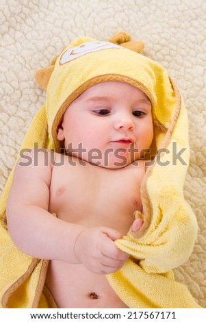 portrait of cute baby in yellow towel