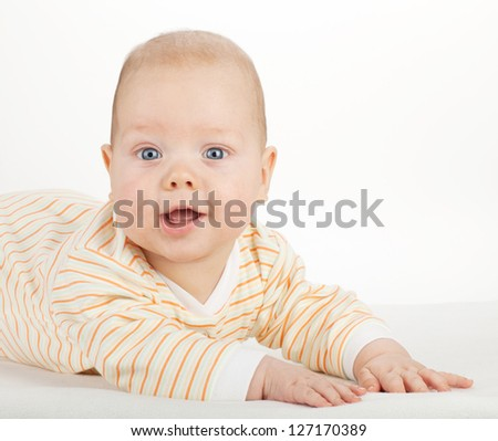 Portrait of cute baby on white