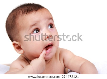 portrait of cute baby with finger in his mouth isolated in white - stock photo