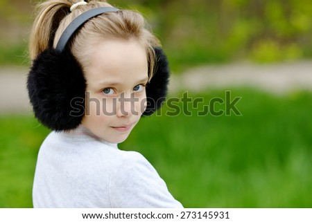 portrait of cute blonde girl outdoors in spring time
