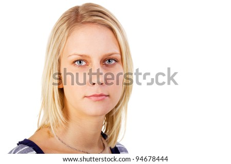 Portrait of cute blonde teenage girl thoughtful looking. Studio shot against a white background. - stock photo