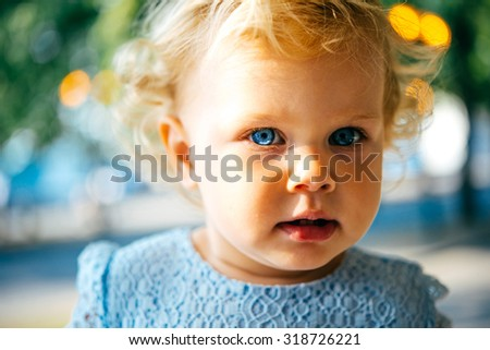 Portrait of cute blonde toddler girl