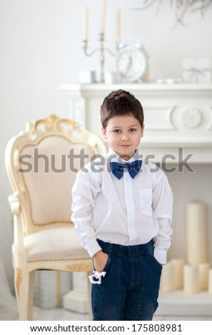 Portrait of cute boy in the luxury room - stock photo