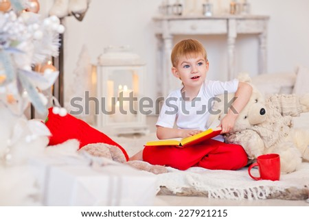 Portrait of cute boy near the christmas tree - stock photo