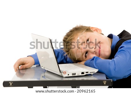 Portrait of cute caucasian boy with laptop over white