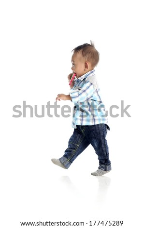 Portrait of cute cheeky toddler walking on the floor isolated on white