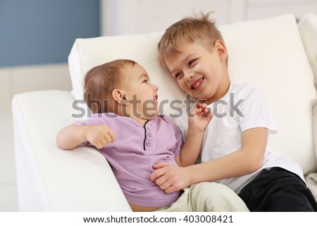 Portrait of cute cheerful brothers in the room - stock photo