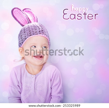 Portrait of cute cheerful Easter bunny, little baby girl wearing pink rabbit ears isolated on blur background with text space, happy spring holidays celebration - stock photo