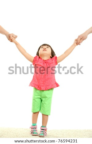 Portrait of cute child being held by her parents - stock photo