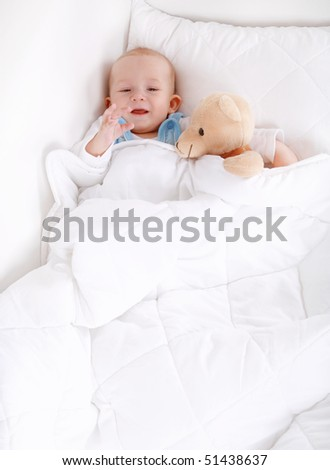 Portrait of cute cute little baby with teddy