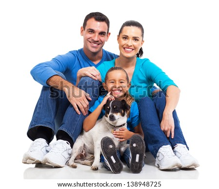 portrait of cute family sitting on floor with their pet dog isolated on white - stock photo