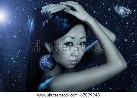 Portrait of cute female fashion model posing on dark background - stock photo