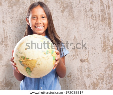 portrait of cute girl holding a world globe - stock photo