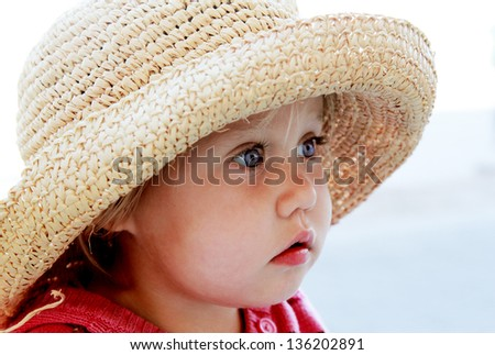 portrait of cute girl in a hat - stock photo