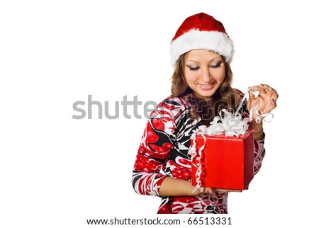 Portrait of cute girl in a Santa cap with gift box. Isolated on white