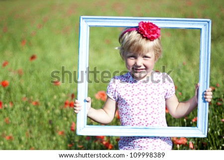 Portrait of cute girl in poppy filed during hot summer day - stock photo