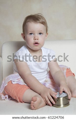 Portrait of cute girl with alarm-clock - stock photo