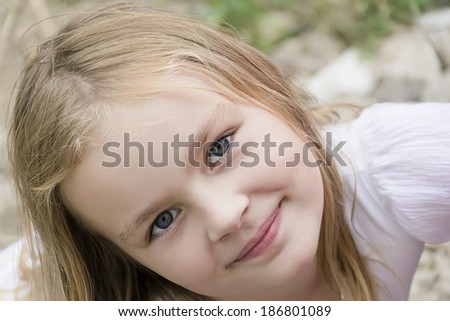Portrait of cute girl with blond hair