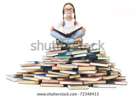 Portrait of cute girl with open book and looking at camera - stock photo
