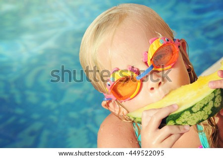 Portrait of cute girl with peace of yellow watermelon